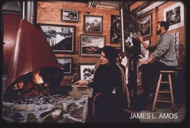 House interior with artist and fire (Photo by Jim Amos of Jim Gray & his wife) 89