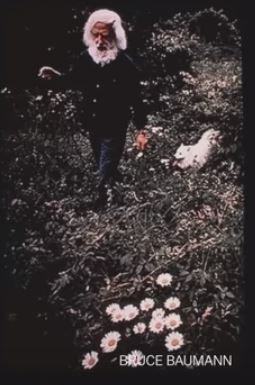 Leo Kenton Coleman with dog and flowers 69